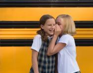 School girls sharing secrets