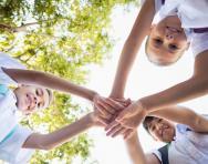 Schoolchildren stacking hands