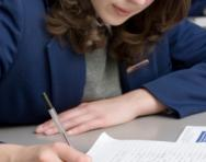 Secondary school girl writing