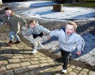 Children playing outdoors in the snow