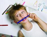 Stressed out child chewing on a pencil