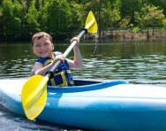 Summer camp boy kayaking