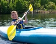 Summer camp boy kayaking