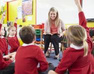 Teacher-children RE discussion in classroom