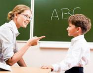 Teacher talking to child