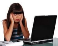 Upset girl at laptop