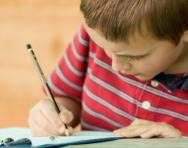 Boy concentrating on work