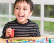 Boy playing board game
