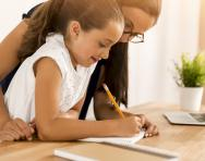 Child and parent writing