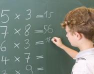 boy doing multiplication