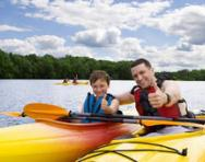 Child learning to canoe