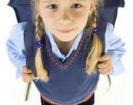 Girl in uniform with backpack