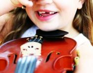 Girl laughing with violin