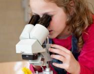 Girl with microscope