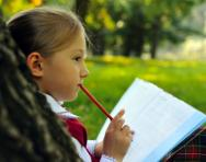 Girl writing in park