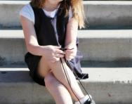 Little girl tying shoe laces