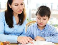 mother and son studying homework