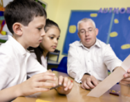 Teacher working with pupils