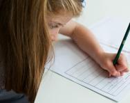 Girl filling in SATs paper
