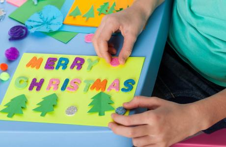 Child making a Christmas card