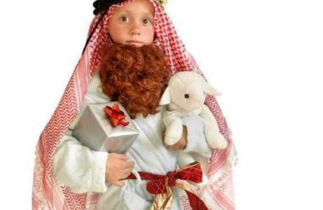 Child wearing a handmade nativity costume