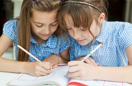 Schoolgirls writing