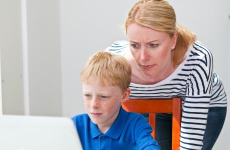Mum and child looking at a computer