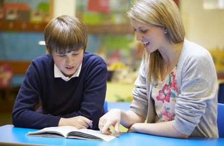 Teacher and pupil reading