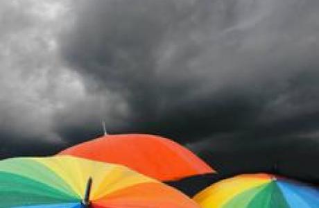 Umbrellas in a storm