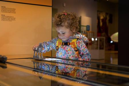 Young child playing games and learning at the Museum of Cardiff