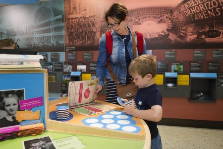 parent and child enjoying activities at the museum