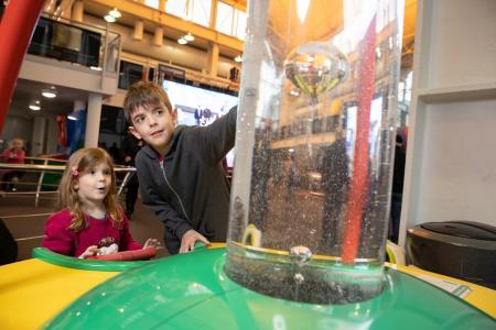 children exploring science museum and learning about STEM