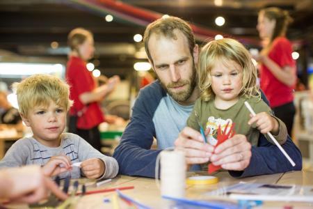 Family taking part in educational activities at We the Curious museum