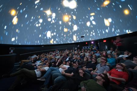 Group of people inside the planetarium